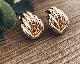 Knots earrings in golden brass