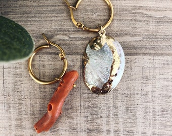 Gold-plated steel hoop earrings with natural shell pendants and coral branch