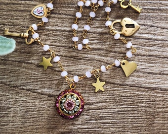 Multicharm necklace with rosary chain, vintage brass pendants and Swarovski pendant