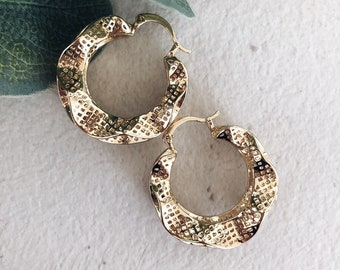 Earrings in gold-plated brass