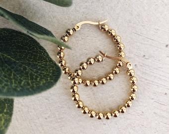 Earrings in gold-plated brass