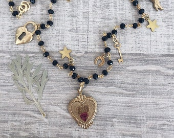 Multicharm necklace with sacred heart and vintage pendants