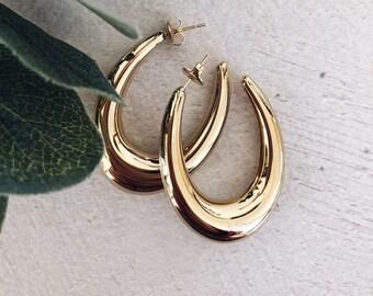 Orecchini cerchi in acciaio dorato