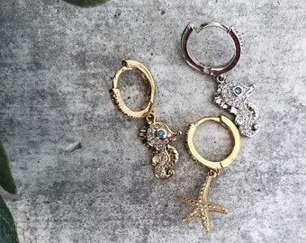 Mono mini circle earring with zircons and seahorse and starfish pendants