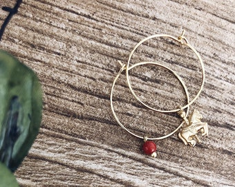 Gold-plated brass hoop earrings with carousel and coral bead