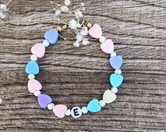 Bracelet with pastel hearts, river beads and letters to compose
