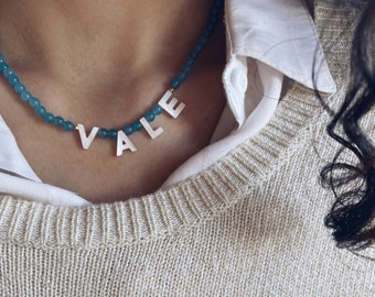 Choker with aquamarine stones and mother of pearl name