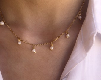 Necklace with thin gold steel chain and small hanging river pearls