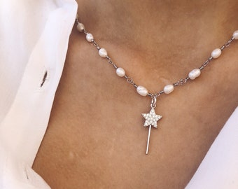 Choker necklace with freshwater pearls and magic wand pendant with zircons