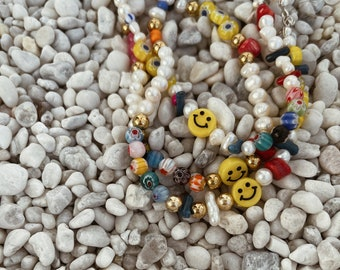 Anklets with river pearls, resin beads, Murano and smile