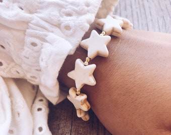 Bracelets with mother-of-pearl stars, gold hematite and steel clasp