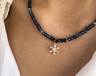 Choker necklace with blue agate washers, hematite beads and snowflake pendant with cubic zirconia