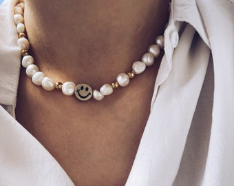 Necklace with natural pearls, golden steel beads and central resin smile