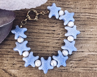 Bracelet with ceramic starfish and river pearls