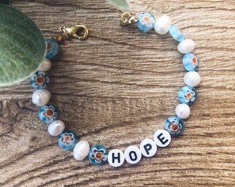 Bracelet with natural pearls, Murano stones and letters to compose