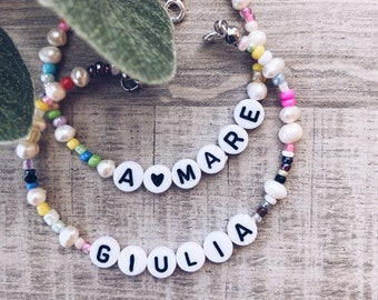 Bracelet with natural pearls, multicolor beads and letters to compose