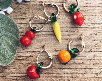 Mono gold-plated steel hoop earrings with glass fruit pendants