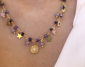 Multicharm necklace with golden brass chain, stones, pendants and initial with zircons