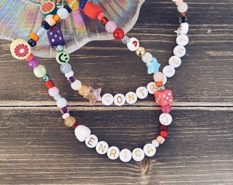 Necklace with colored resin beads and letters to compose