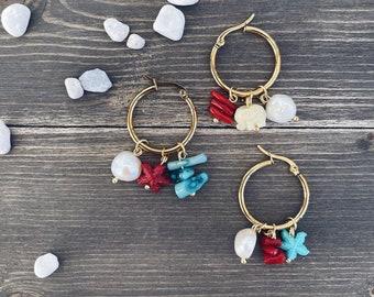 Mono steel hoop earrings with sea-themed multicharm