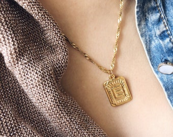 Necklaces with gilded steel chain and gold brass bath start