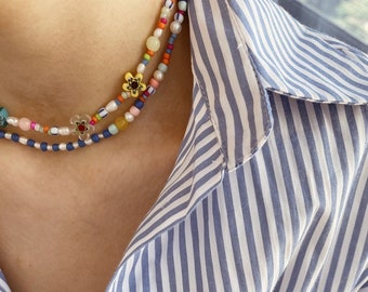 Necklaces with colored resin beads and Murano flowers - set of two necklaces