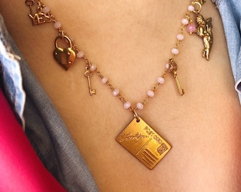 Multicharm necklace with rosary chain and vintage brass pendants