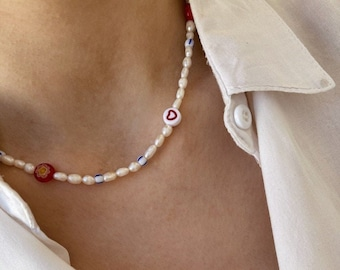 Necklaces with river pearls, red Murano beads and resin hearts