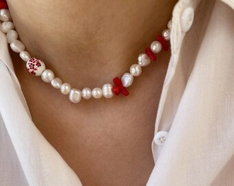 Necklace with freshwater pearls, hand painted ceramic beads and coral paste chips