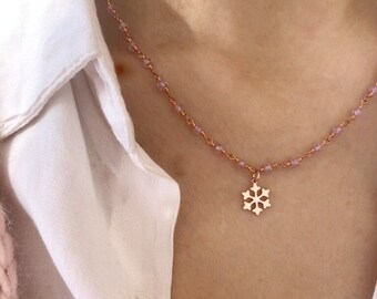 Necklace with pink chain with pink zircons and snowflake pendant