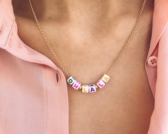 Necklace with golden brass chain and multicolor cube letters