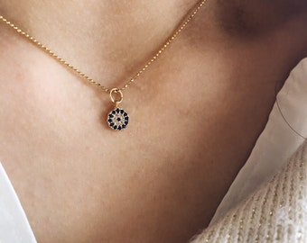 Necklace with golden silver chain with small balls and pendant with Greek eye zircons