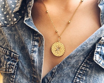 Necklaces with gold-plated steel chain and gold-plated brass pendant with central crystal