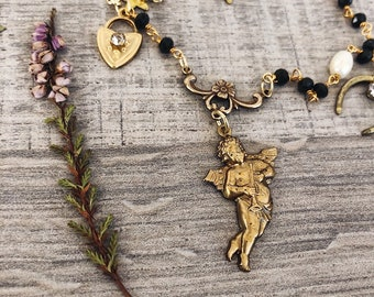 Necklaces with rosary chain and vintage brass pendants