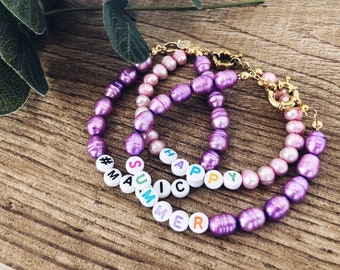 Bracelets with colored pearls and letters