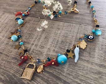 Multicharm necklace with vintage charms and glazed and aluminum madonnine pendants
