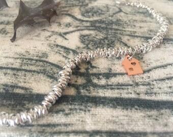 Bracelet in aluminum with home pendant