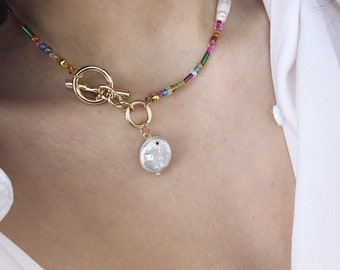 Necklace with multicolor mini beads, rectangular pearls and flat pendant pearl