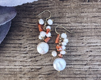 Cluster earrings with river pearls, final flat pearl and coral sprigs
