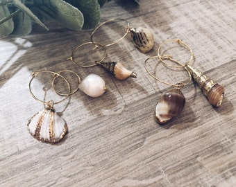Brass hoop earrings with shells and pearl charms pendants