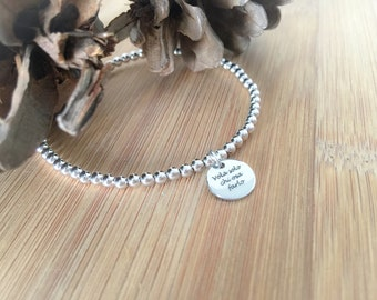 Silver bracelet with pendant engraved laser
