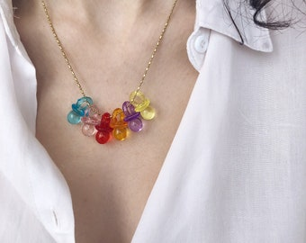 Necklace with golden brass chain and pacifier pendants in colored resin