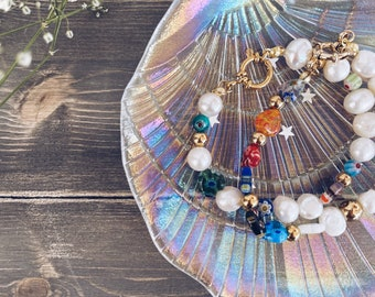 Bracelets with river pearls and Murano millefiori stones