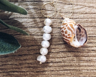 Gold-plated brass hoop earrings with natural shell and pearl pendants