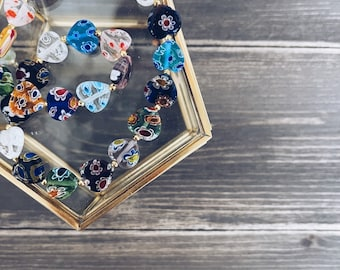 Necklace with Murano millefiori stones heart and golden steel beads