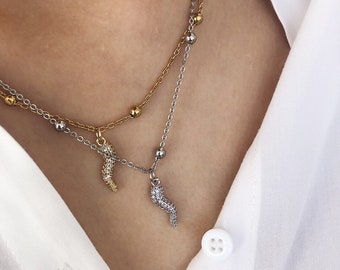 Necklace with steel chain with beads and silver croissant pendant with cubic zirconia