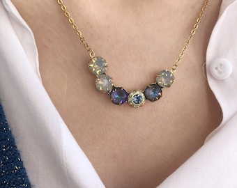 Necklace with steel chain and half moon in gold plated brass with Swarovski