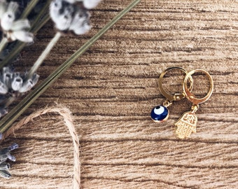 Brass hoop earrings with blue Greek eye pendant and hand of Fatima
