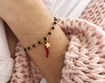 Bracelet with rosary brass chain with beads and golden or red horned pendant and starlet