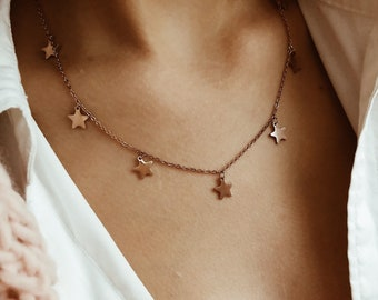 Rosé steel necklace with hanging stars